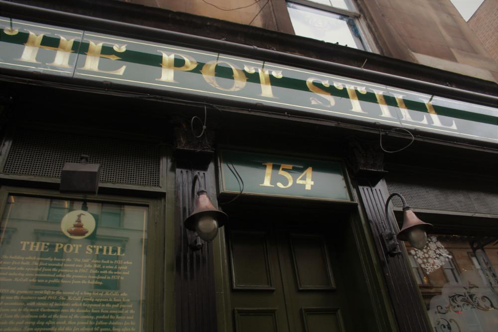 Front door sign of the Pot Still pub
