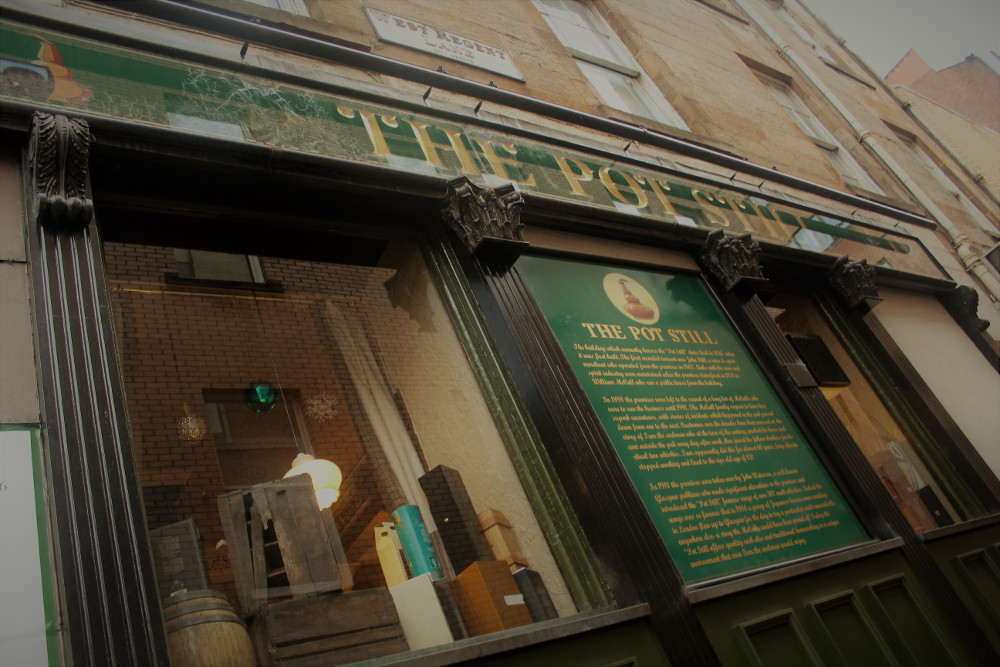 Sign explaining the name and history of the Pot Still pub