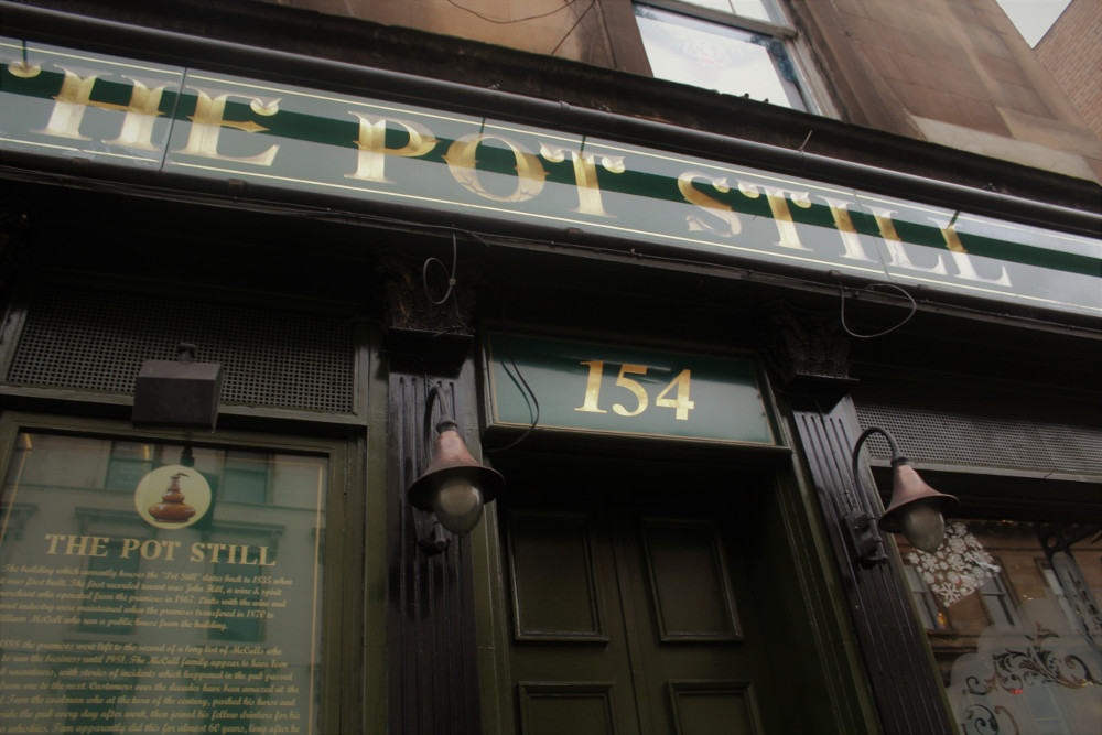 Front door sign of the Pot Still pub